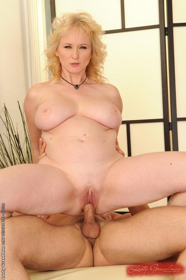 Blonde nude with speculum